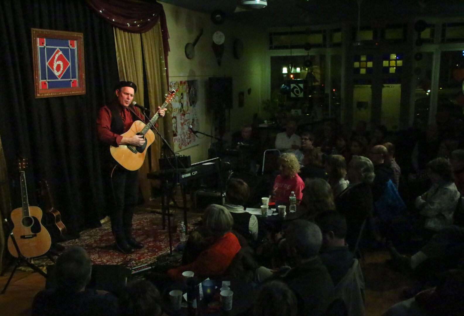 Greg Greenway performing music in front of a live audience