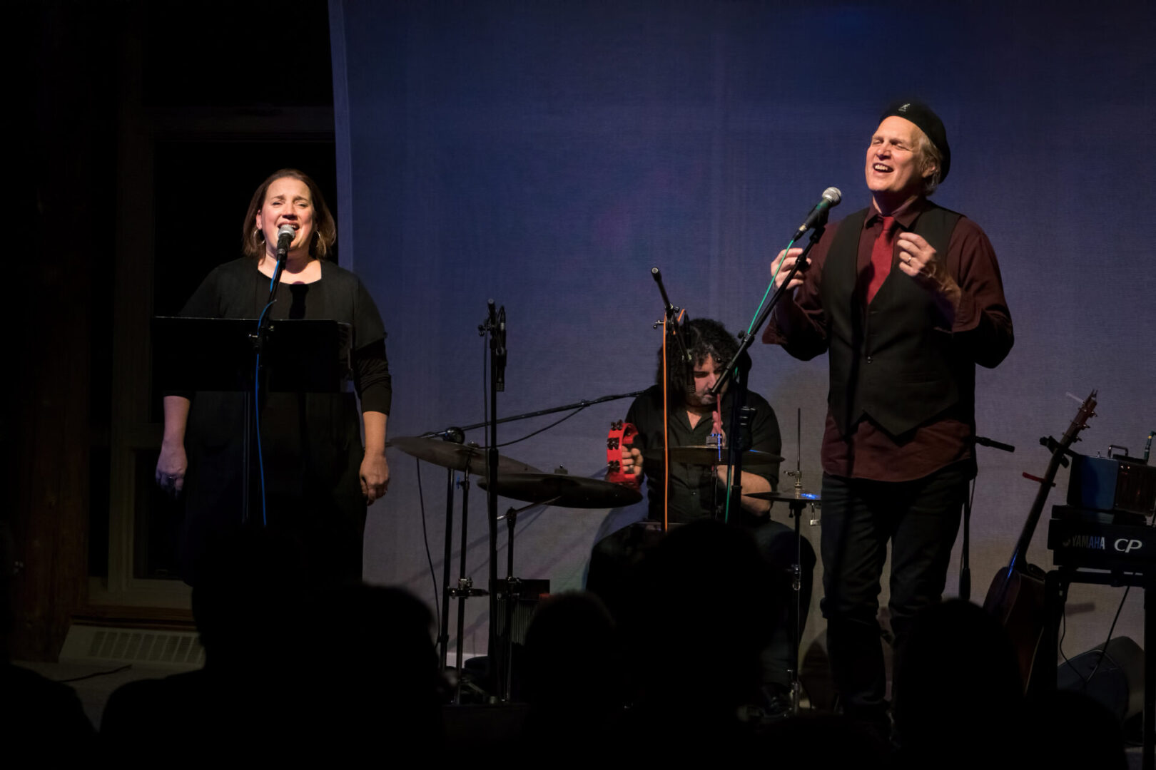 Greg Greenway performing live with two other musicians